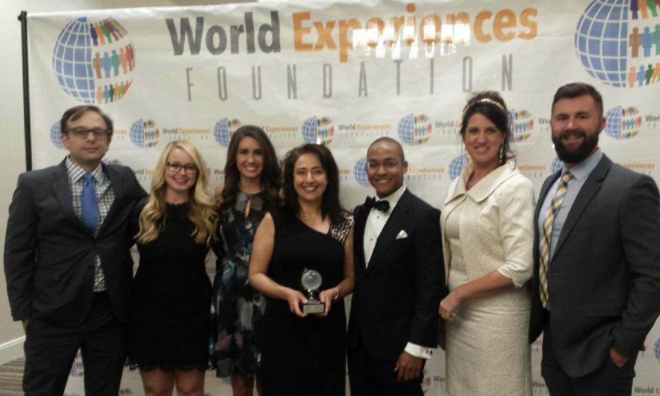 Professor Aswad (center) accepts the Global Citizen in Law and Politics Award at the World Experiences Foundations annual gala, held Sept. 9, 2017. Aswad is pictured with alumni of her courses, who have worked together to grow OU Law's International Business and Human Rights Center.